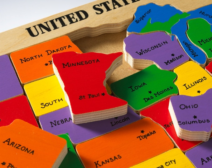 US Map Puzzle. Educational toy puzzle for learning and teaching preschool elementary school children their geography of states and capitals.