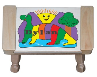 Personalized Name Puzzle Step Stool Dinosaur Theme.  An educational toy puzzle that teaches preschool toddler children their name & colors.