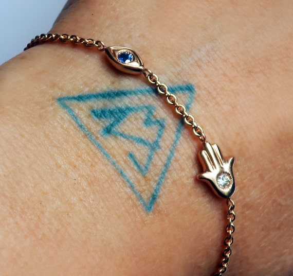 14 karat Gold, White Diamond and Blue Sapphire, Evil Eye Hamsa Bracelet