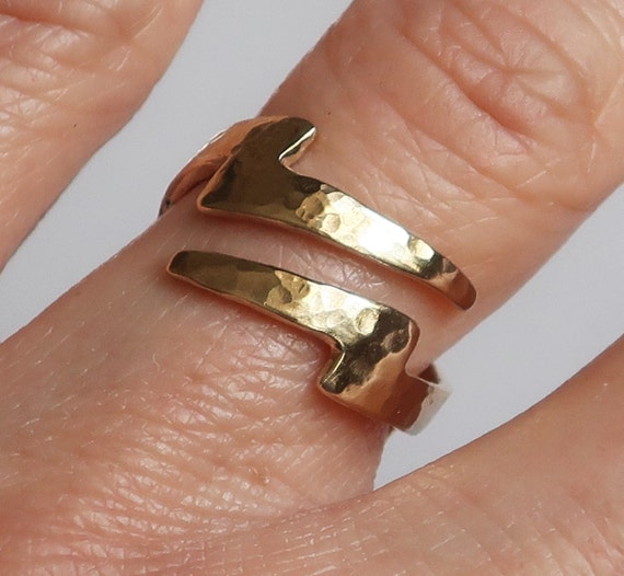 Gold Lightning Bolt Ring with tapered ends.