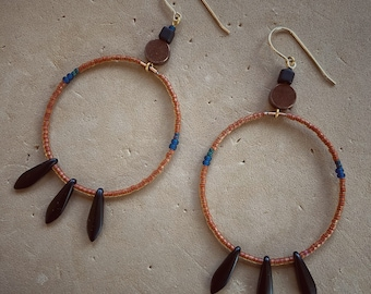 Rust Loops with Matte Black Feathers  on Goldfill earwires
