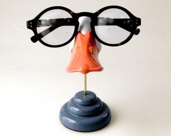 5530b1942c888 Duckbill eyeglass stand