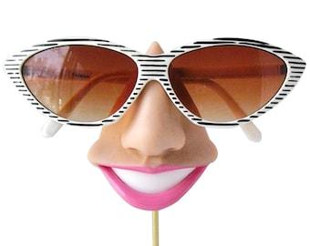 Smiling eyeglass holder, nose sunglasses display,  eyewear display stand