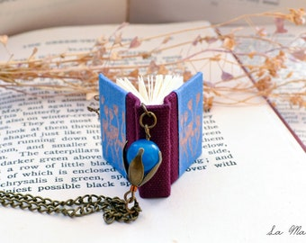 Book Necklace. Miniature light blue and burgundy red book with bronze flowers and blue bead