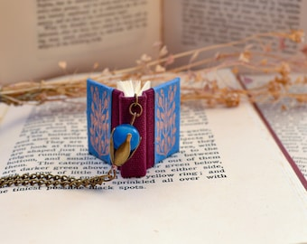 Book Necklace. Miniature light blue and burgundy red book with bronze leaves and purple bead