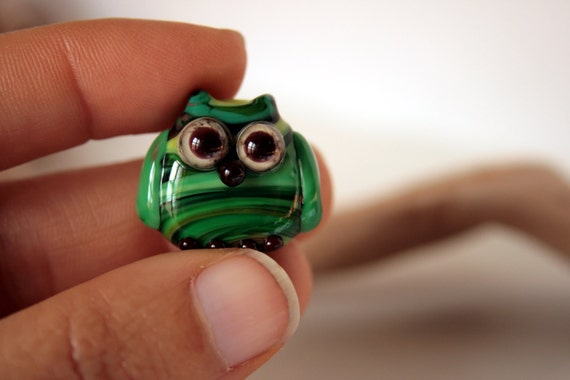 Glass bead, owl mascot, striped in shades of green. made of Italian glass. by GhirigoriGlass