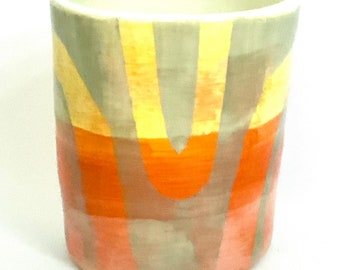 Handmade ceramic planter pot with minimal geometric orange and grey waves