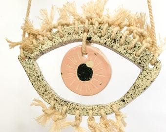 Handmade ceramic eye, wall hanging, pottery, pink, macrame
