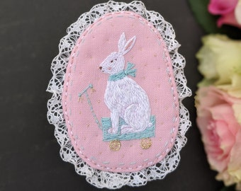White Rabbit Brooch. Bunny on the wheels pin. Hand embroidered textile brooch. Easter Gift. Rabbit embroidery. Pastel color brooch. Pink pin