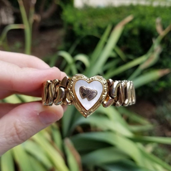 Vintage Art Deco gold filled mother of pearl heart shaped stretch expansion sweetheart bracelet, signed Speidel Made Phoenix