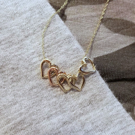 Delicate modern estate 10k yellow and rose gold five nestling floating heart charm necklace