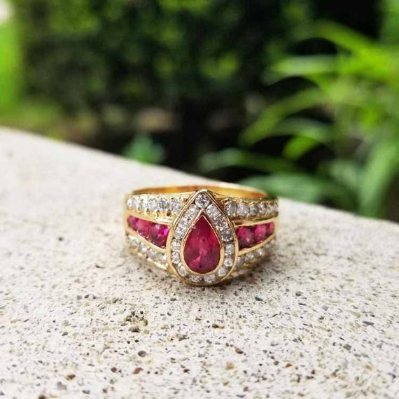 Modern estate 14k gold channel set and bezel set pear shaped 1.25 carat ruby and .75 carat diamondwide band ring, size 10-1/4