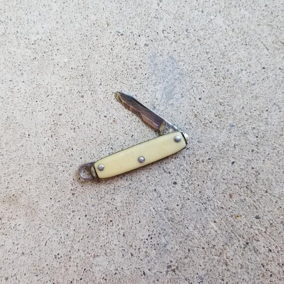 Vintage tiny miniature composite USA made pocket knife fob, single blade, folding knife, pendant bail, charm, necklace