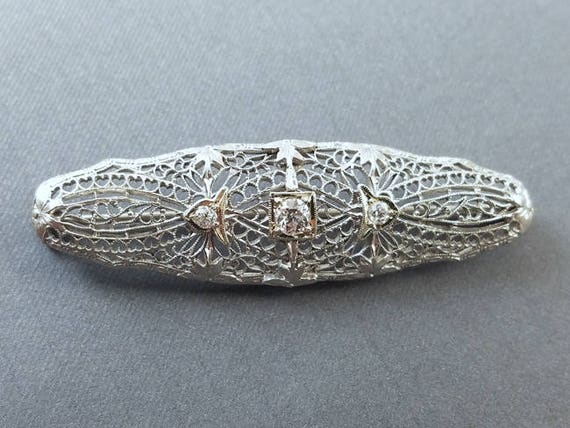 Antique Art Deco 14k white gold .22 carat diamond brooch pin with heart shaped filigree