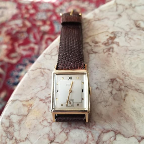 Vintage mid century 14k gold Elgin DeLuxe tank wrist watch circa 1940-50