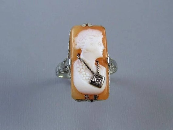 Vintage Art Deco 14k white gold filigree cameo wearing a Hawaiian lei  diamond En Habille ring, size 7, 1920s, flapper