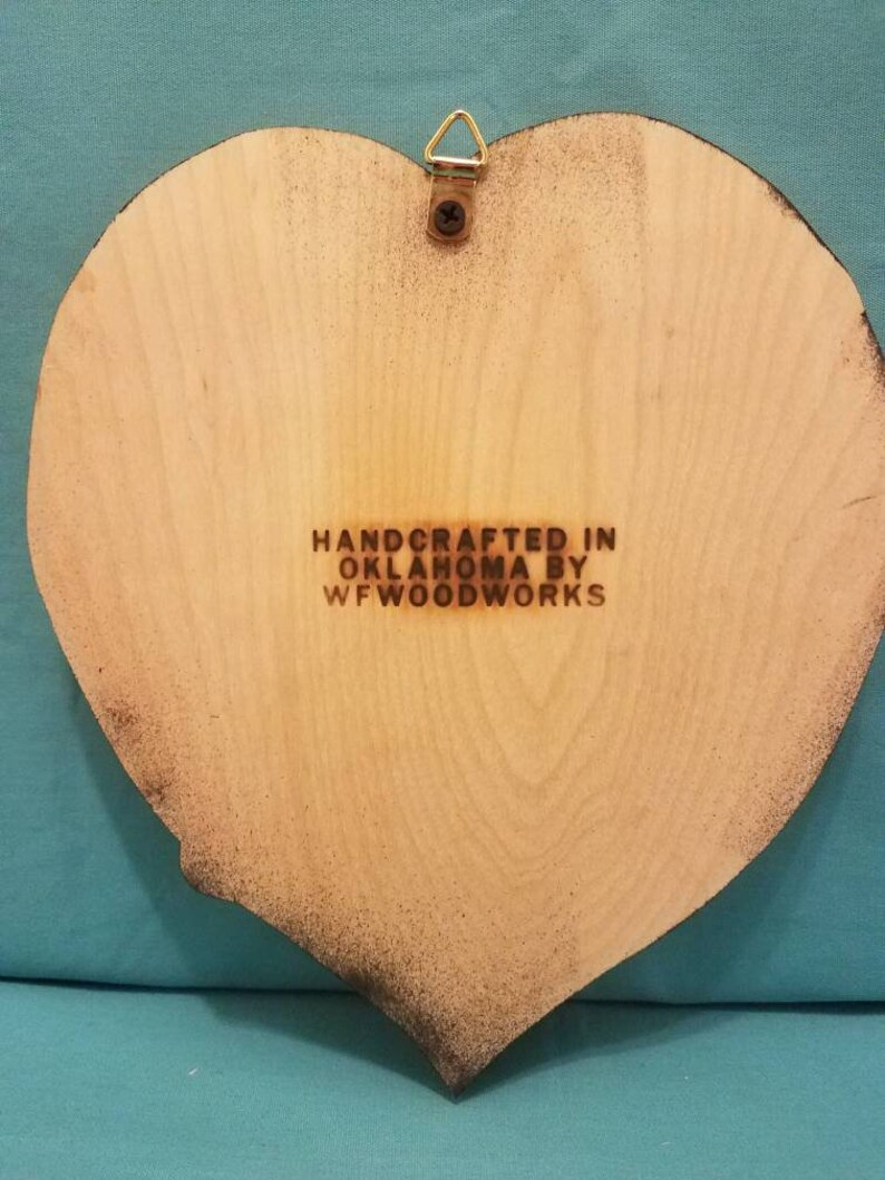 hand crafted with a scroll saw Veterans plaque which reads God bless our vets