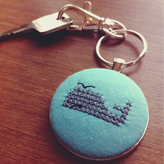 Blowhole. Old school pixelated cross stitch whale keychain.
