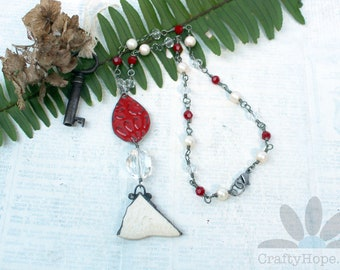 Found Collection Necklace - red and white, crystals, glass beads, Mobile bay pottery shard, embossed old tin, assemblage, OOAK, unique