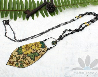 Floral Crest Necklace - reclaimed flower tin, blackened steel wire, salvaged bead, glass beads, stone beads, gunmetal chain, yellow black