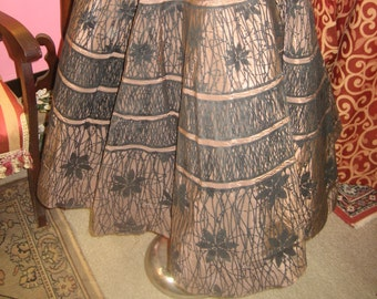"1950's, 30"" waist, stiff brown taffeta circle skirt."