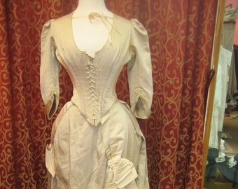 "1880's, 34"" bust, ecru silk faille, bustled  and trained skirted wedding gown museum quality."