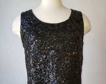 """1960's, 38"""" bust, beaded and sequined black wool shell,"""