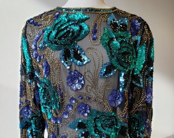 """1980s, 38"""" bust, black polyester top, entirely covered with green and blue sequins"""