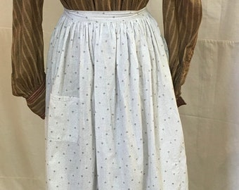 1890s , small check and tiny flower print on white background, full length cotton apron.