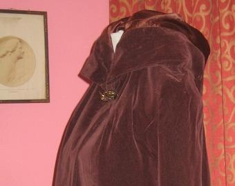 """1950's, 42"""" bust, eggplant colored velveteen full length hooded cape."""