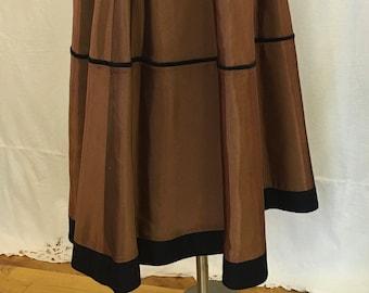 "1980s, 24"" waist, copper brown taffeta, circle skirt."