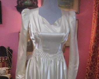 "1938, 34"" bust, bright off white satin, train back wedding gown."