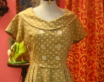 "1950's, 36"" bust, double breasted linen dress of cream colored polka dots"