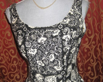 """1950's, 34"""" bust dress is of waffled cotton black and white tropical print."""