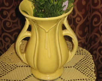 "1940's, 9"" tall, lemon yellow ceramic McCoy vase."
