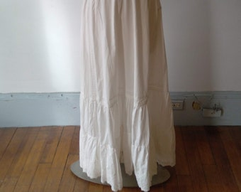 """1890s, 22"""" waist, white cotton broadcloth, bustle trained back petticoat."""