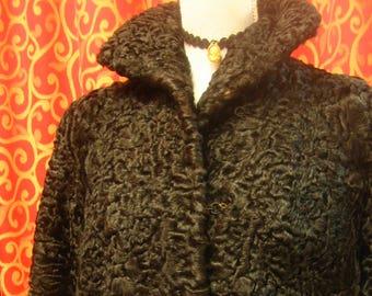 "1950's, 40"" bust, jet black Persian lamb coat."