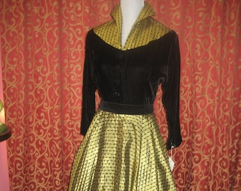 "1950's, 36"" bust, black velvet, raglan sleeved top with wide circle skirt of gold nylon"