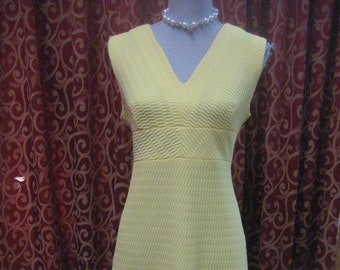 """1970's, 38"""" bust, 2 piece waffle pressed polyester yellow dress and matching jacket."""