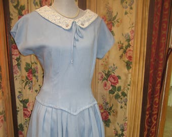 "1950's, 40"" bust, powder blue gaberdine low waist dress."