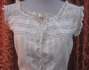 "1890's, 34"" bust, white linen and lace corset cover."