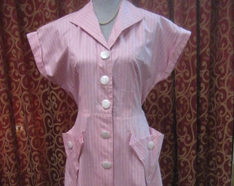 """1950's, 40"""" bust, pink cotton dress with very fine white lines."""