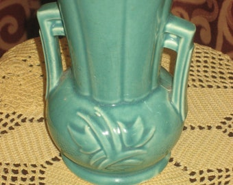 "1940's, 9"" green ceramic McCoy vase."