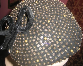 "1950's, size 22"" . brown felt hat,  covered with gold star shaped sequins"