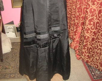 "1890's, 28"" waist, black silk A lined full length skirt"