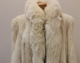 """1980s, 44""""chest, full length white mink coat, fully lined in white satin."""