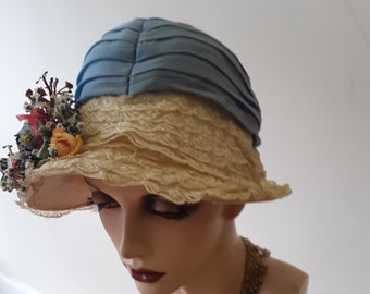 1920s, size 23, periwinkle blue silk crepe pleated crown hat with narrow lace trimmed wired brim