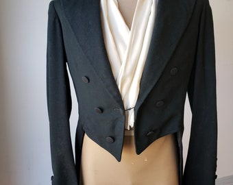 """1890-1900, 40""""chest, black wool, with black silk lapels, double breasted  formal swallow tail jacket."""