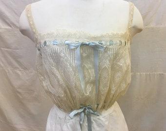 """1915, 40"""" bust, ecru lace camisole."""
