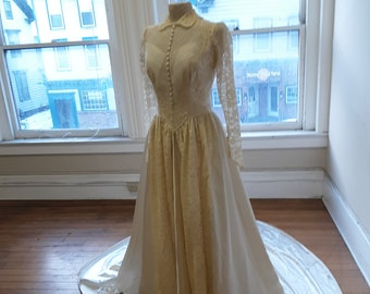 """1950s, 38"""" bust, ecru lace and satin, cathedral trained wedding gown."""